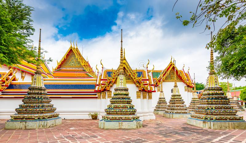 Wat Pho temple in Bangkok city, Thailand. View of pagoda and stupa in famous ancient temple. Religious buildings in buddhism style. Near Grand Palace. Oriental royalty free stock photo