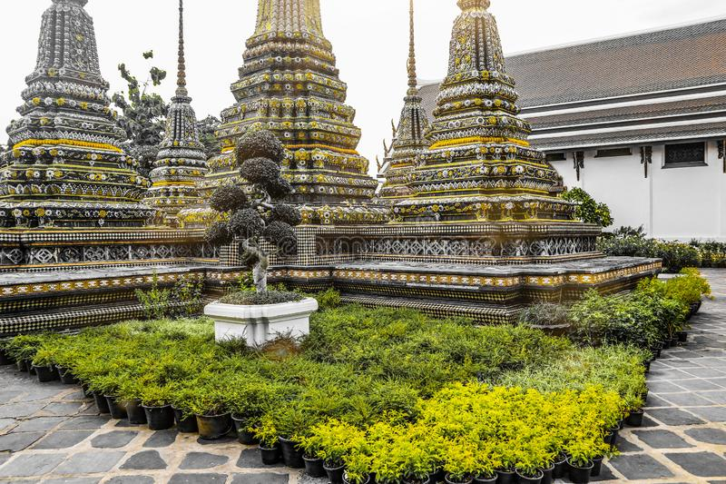 Wat Pho  Temple of the Reclining Buddha, or Wat Phra Chetuphon, is located behind the Temple of the Emerald Buddha and a must-do stock photography