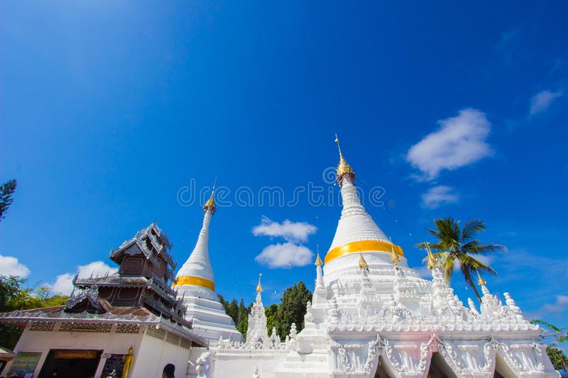 Mae Hong Son province,Northern Thailand on November 19,2017: Burmese style white chedis with beautiful sky at Wat Phra That Doi Ko stock image