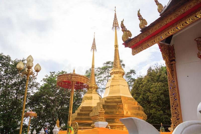 Wat Phra That Doi Tung temple with public domain has two golden pagodas or stupas containing Buddha`s relic, considered as a treas stock images
