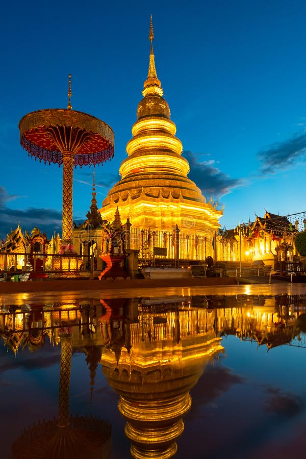 Wat Phra That Hariphunchai with water reflection in Lamphun stock photos