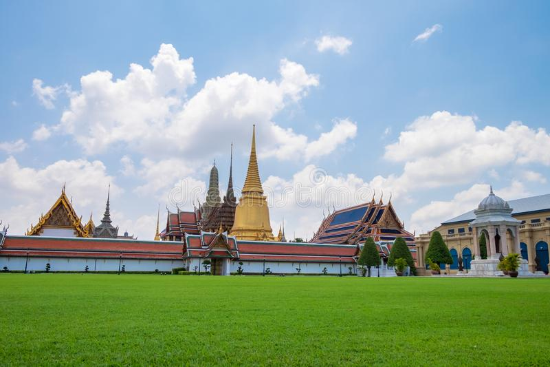 Wat Phra Keaw, the Temple of the Emerald Buddha with green grass, Bangkok. Thailand royalty free stock image
