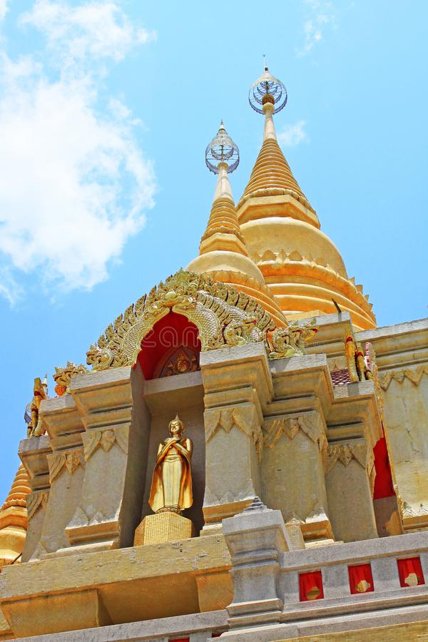 Wat Phutthathiwat, Betong, Thailand. Wat Phutthathiwat is located on a hilltop in Betong city center. This chedi is built in the modern Sivijaya style, covered stock photo