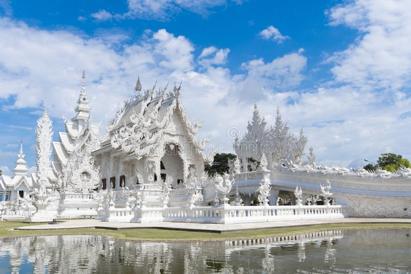 Wat Rong Khun White temple in Chiangrai, Thailand. During summer time stock photography