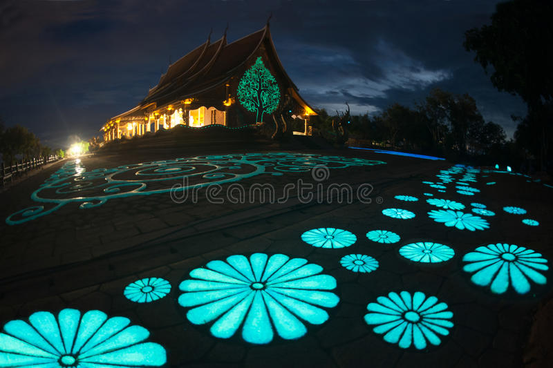 Wat Sirindhorn Wararam Phu Prao temple in Northeast of Thailand. This Buddhist temple boasts the main hall with nice artwork that is illuminated at dusk. The stock image