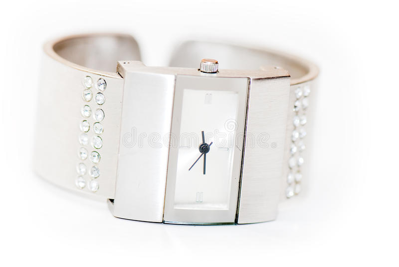 Watch. Womanish watch on the white isolated background. jeweller decoration stock photography