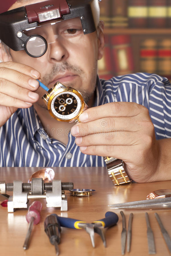 Watch. Repair craftsman repairing . Focus on stock image