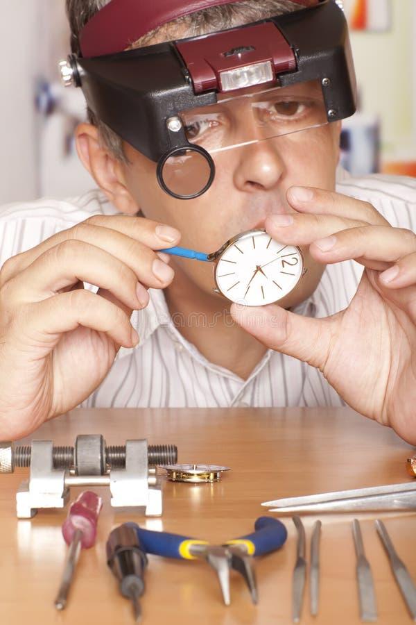 Watch. Repair craftsman repairing  Focus on royalty free stock images