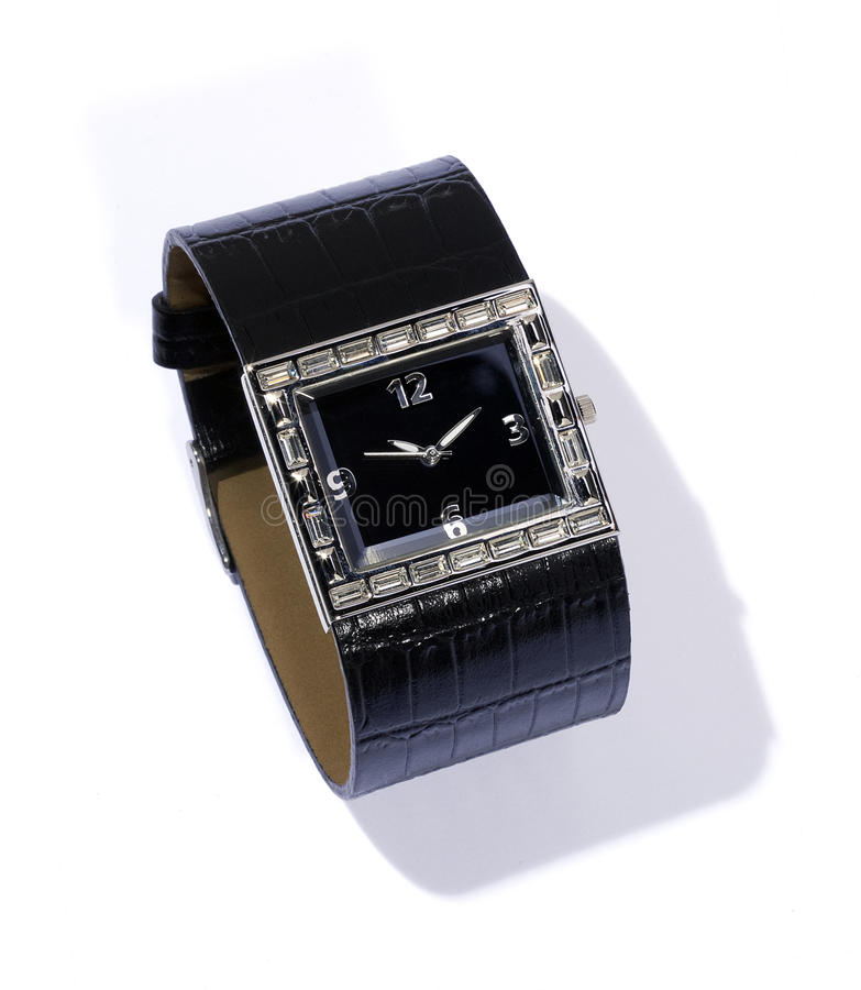 Watch with black leather bracelet. In a studio-shot in front of white background stock photos