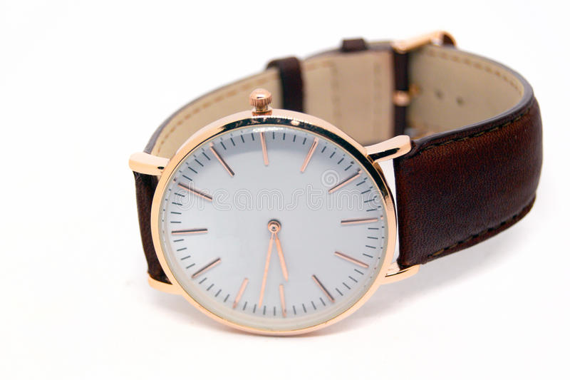 Watch. Classic rose gold watch with white dial stock photos