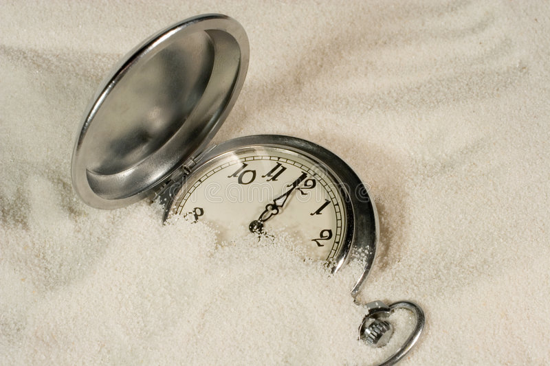 Watch covered with sand stock photos