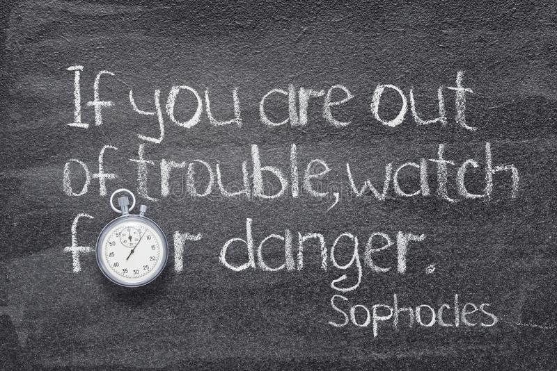 Watch for danger Sophocles. If you are out of trouble, watch for danger - quote of ancient Greek philosopher Sophocles written on chalkboard with vintage royalty free stock photography