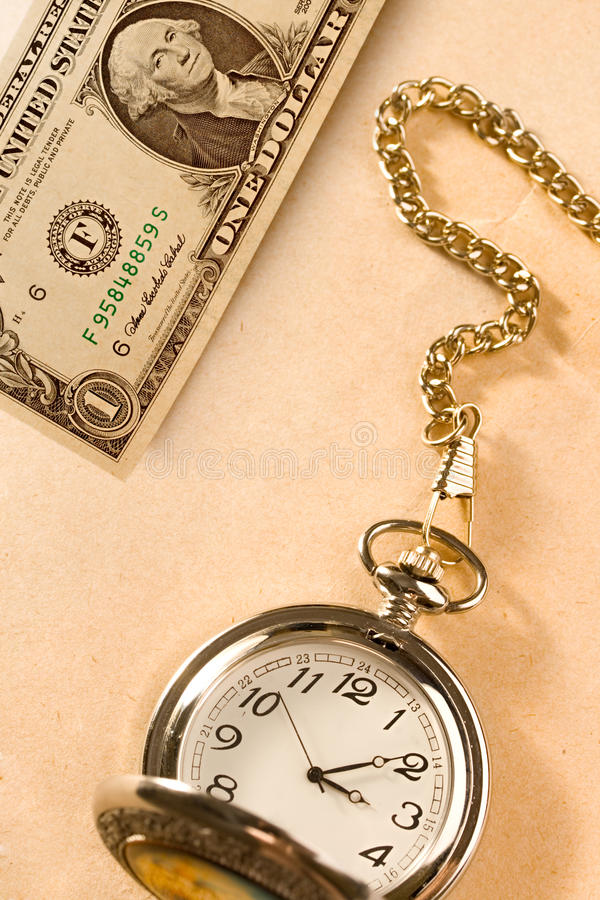 Watch and dollar. Isolated on papper background royalty free stock images