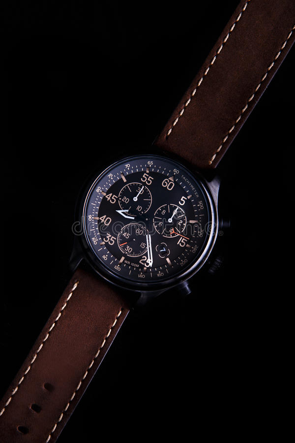 Watch expedition arrow with brown leather strap royalty free stock image