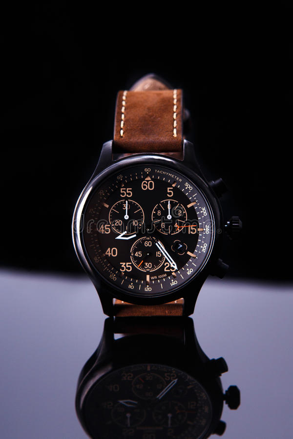 Watch expedition arrow with brown leather strap stock photo