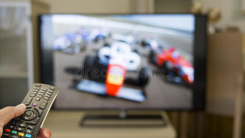 Watch formula races on television royalty free stock photo