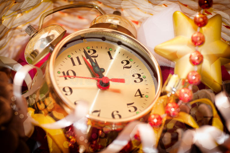 Watch hands by 12 hours and Christmas toys. Background closeup royalty free stock image