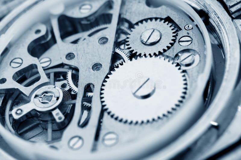 Watch mechanism. Detail of watch mechanism cogs stock images