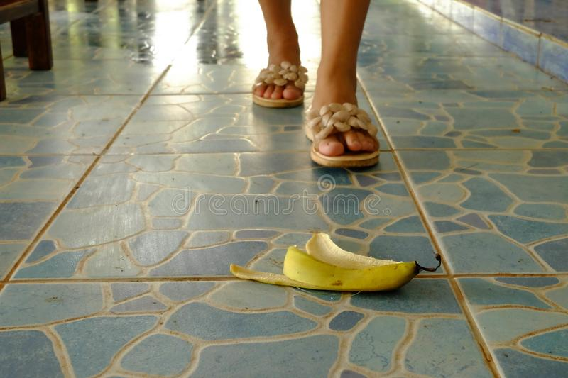 The banana skin lies on a walkway. Watch out for the banana skin lies on a walkway royalty free stock image