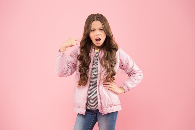 Watch out. Moody girl. Modern fashion for kids. Clothes store. Autumn season collection. Street style outfit royalty free stock photo