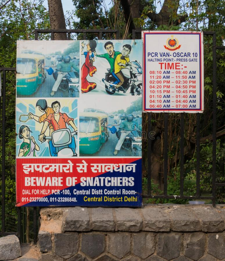 Watch Out For Snatchers Sign in New Delhi, India. A watch out for Snatchers sign in a park in New Delhi, India royalty free stock photo