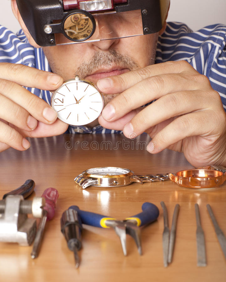 Watchmaker. Watch repair craftsman repairing watch. Focus on watch royalty free stock photos