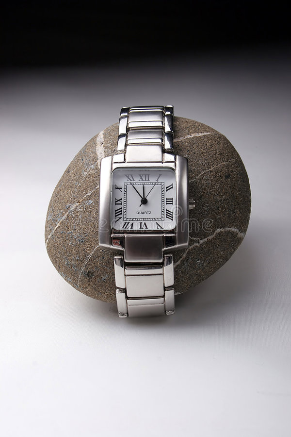 Watch on a rock. stock photography