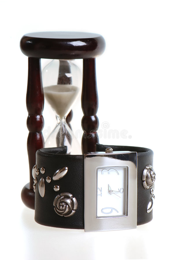 Watch and sandglass stock image