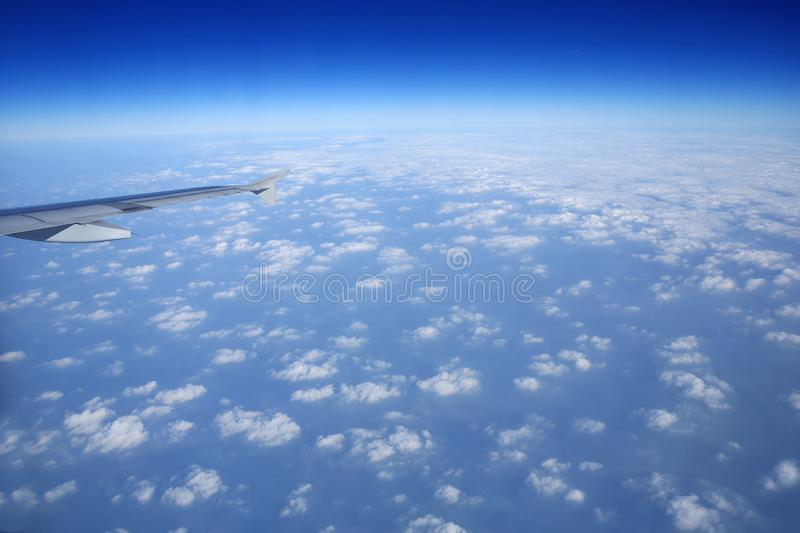 Watch the sea of clouds on the plane stock photography