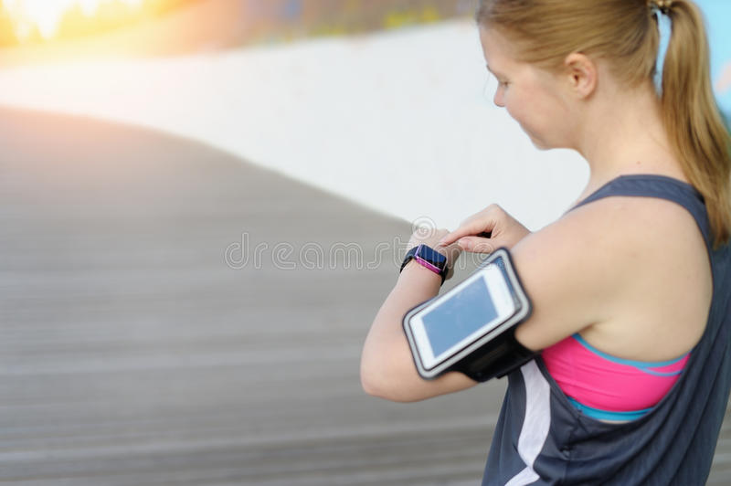 Watch for sports with smartwatch. Jogging training for marathon. Watch for sports with smartwatch. Jogging training for marathon royalty free stock images