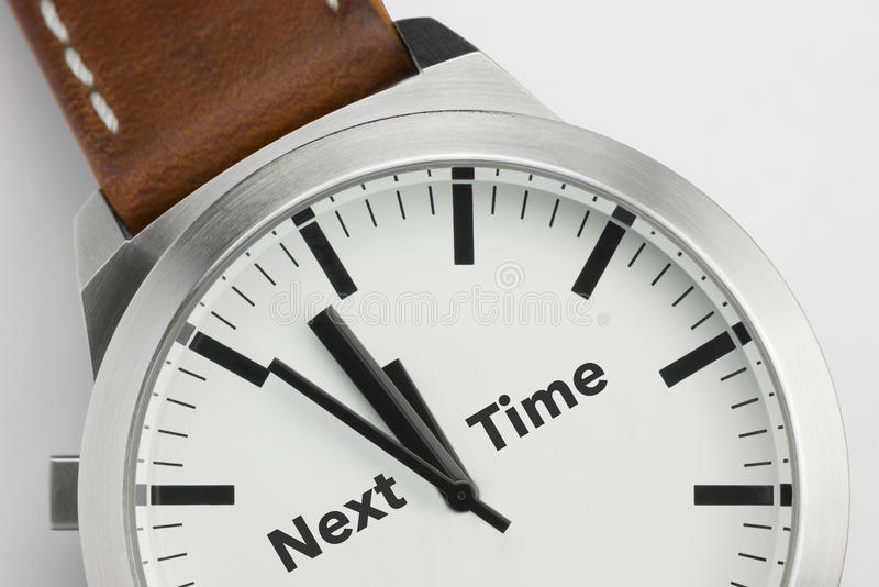 Watch with text Next Time stock images