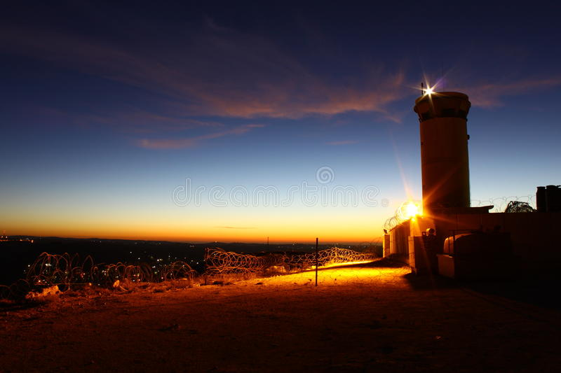 Watch tower. A watch tower at sunrise royalty free stock photos