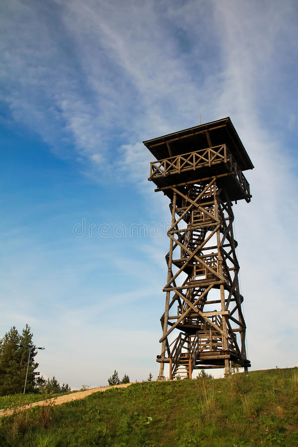 Download A watch tower stock photo. Image of grass, cloud, building - 20086360