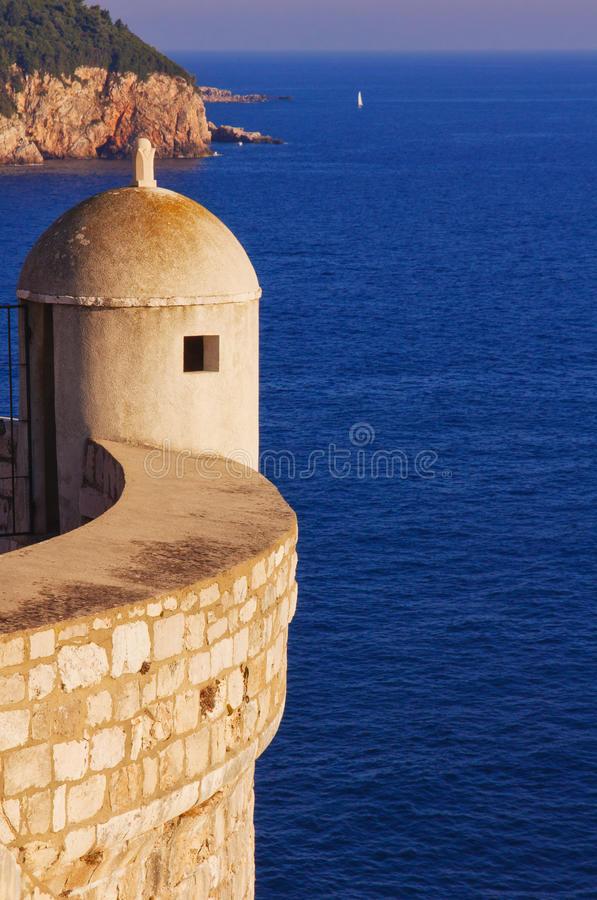 Watch tower on corner of ancient town wall. In Dubrovnik at sunset stock image