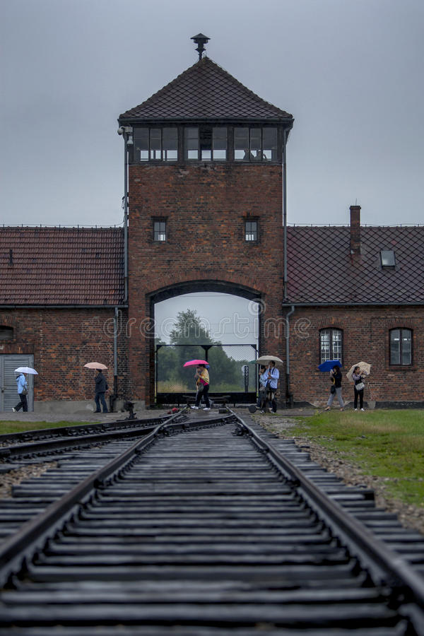 The watch tower at the entrance to the Auschwitz-Birkenau Concentration Camp at Oswiecim in Poland. Millions of prisoners were transported to the camp via this stock photo