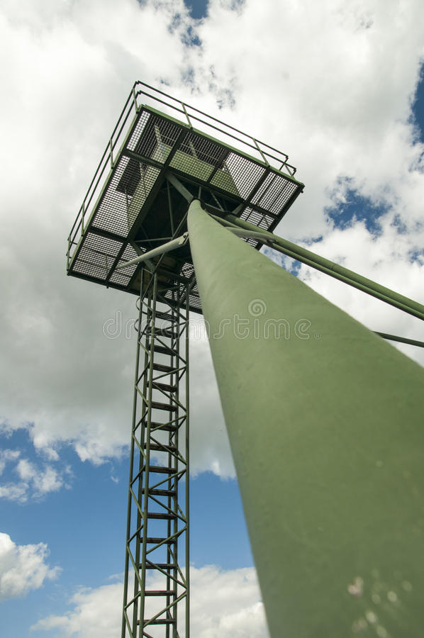 Watch tower of iron curtain. Iron curtain metal green watch tower stock image