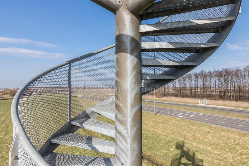 Watch-tower made of spiral staircases near Lelystad Airport, The Netherlands. Detail of watch tower made steel spiral staircases near Lelystad Airport in The stock photos