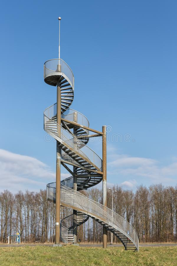 Watch-tower made of spiral staircases near Lelystad Airport, The Netherlands. Watch tower made of two steel spiral staircases near Lelystad Airport in The royalty free stock photo