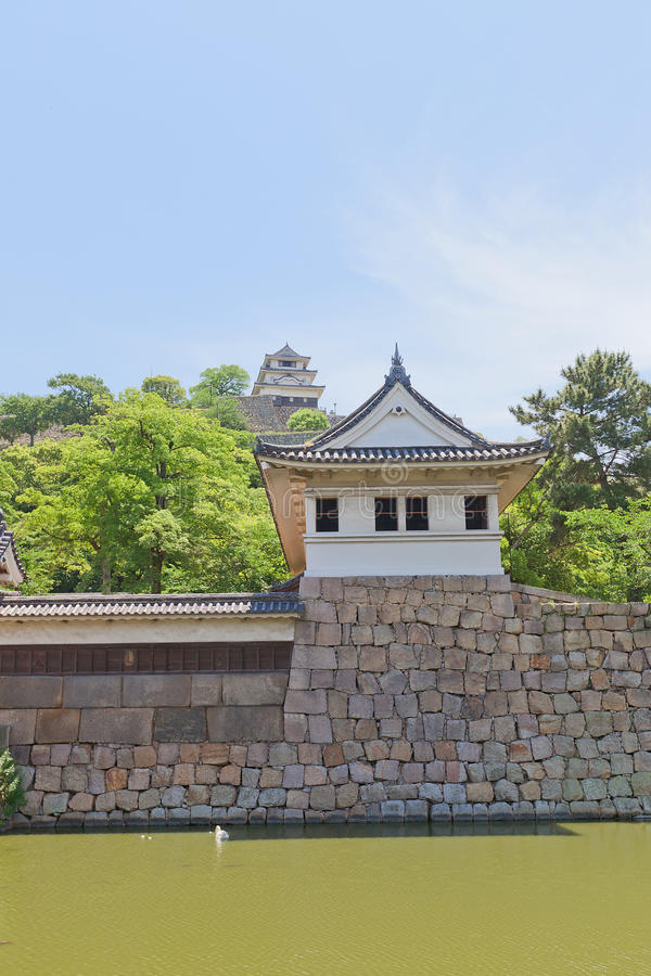 Watch tower and main keep of Marugame castle, Japan. Watch tower and main keep (donjon) of Marugame castle, Shikoku Island, Japan. One of only twelve survived stock image