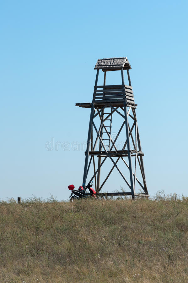 Watch Tower and Motor Scooter. In Grass royalty free stock photos