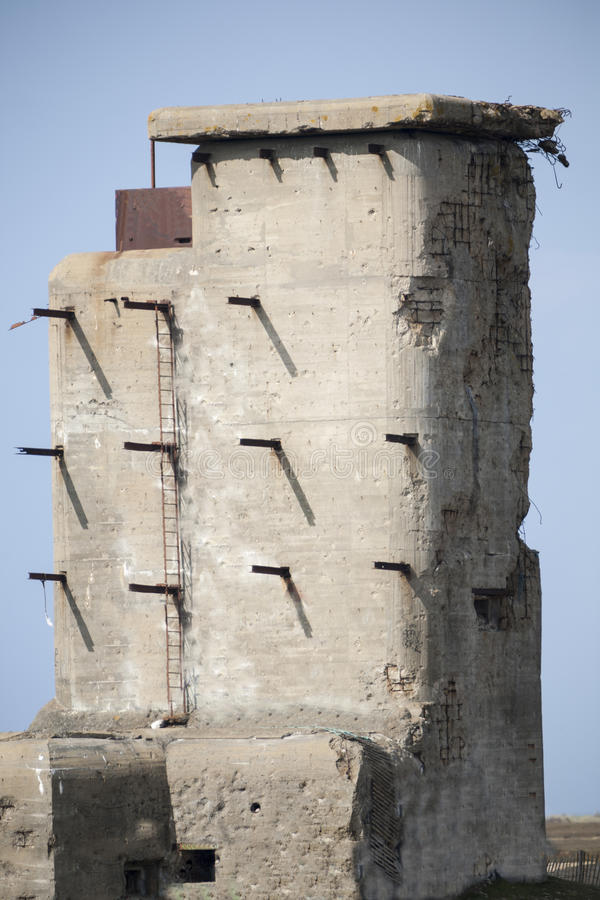 Watch tower. Ruins of a giant watch tower in atlantic wall coastline in France stock image