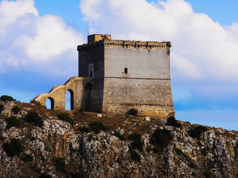 Watch tower on Salento coast. Typical ancient watch tower along the Salento coast in Puglia, southern Italy royalty free stock images