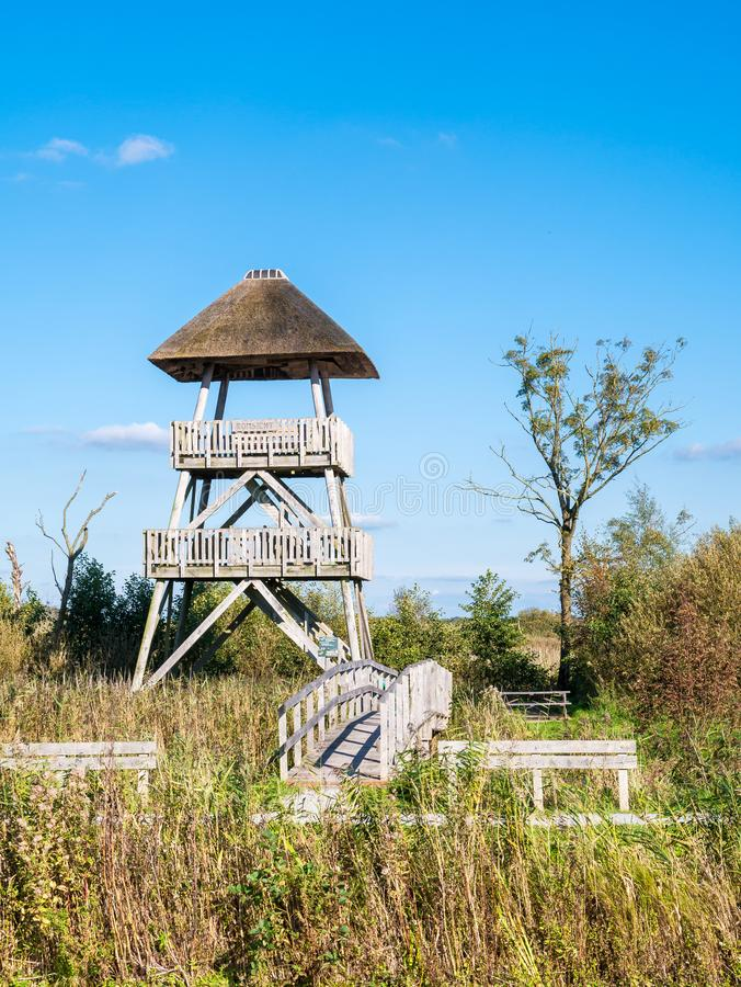 Watch tower with viewing platform in national park Oude Venen, F. Wooden watch tower with viewing platform in nature reserve national park Oude Venen near royalty free stock photography