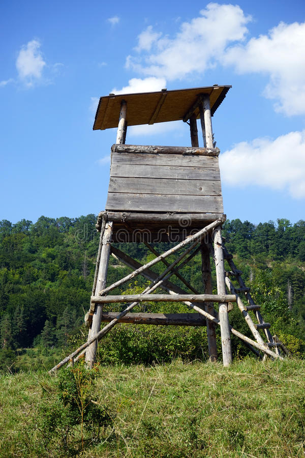 Watch tower. Wooden watch tower on the green farm field in Germany royalty free stock image