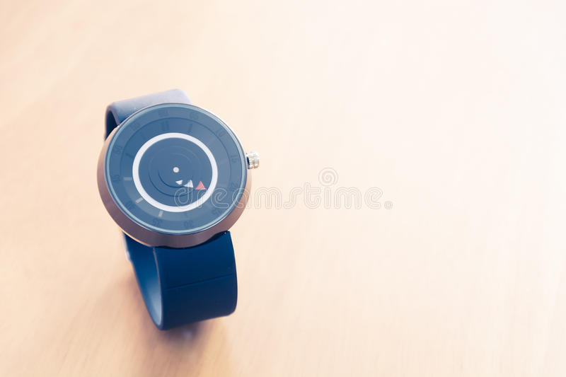 Watch on wood background. Soft focus with vintage filter stock photos