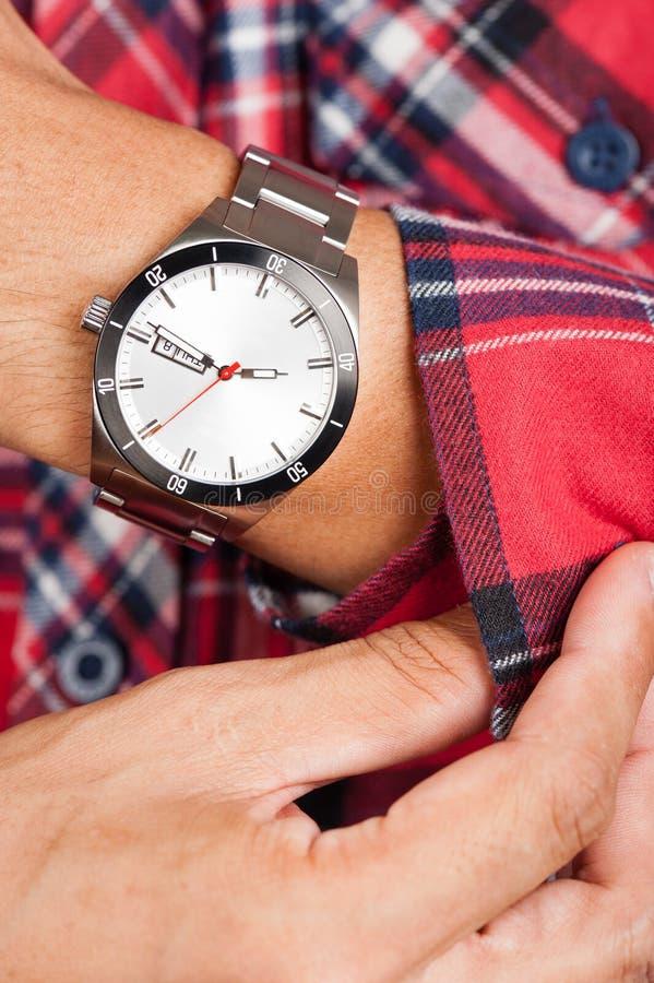 Watch on wrist. Closeup beauriful luxury watch on man`s wrist stock image