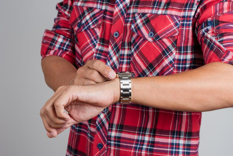 Watch on wrist. Closeup beauriful luxury watch on man`s wrist royalty free stock photos