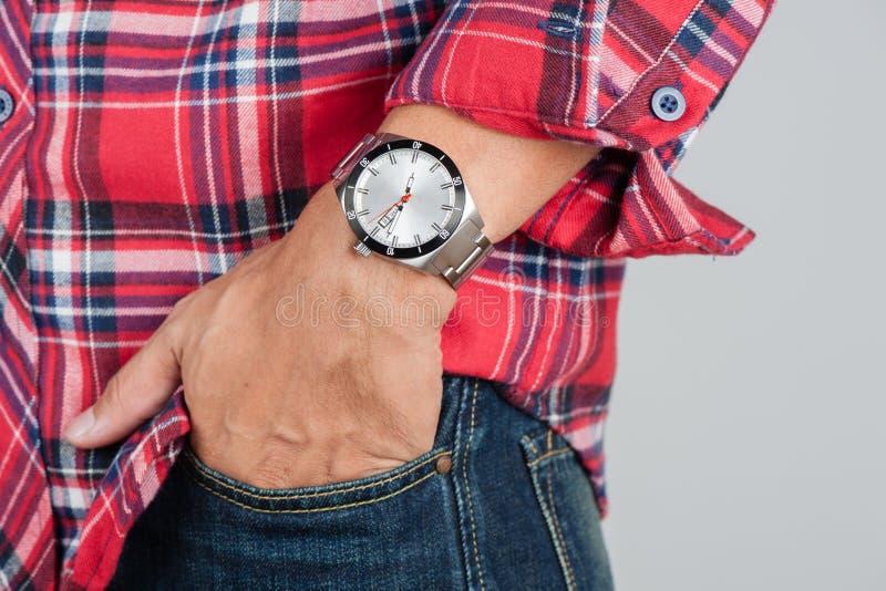 Watch on wrist. Closeup beauriful luxury watch on man`s wrist stock photography