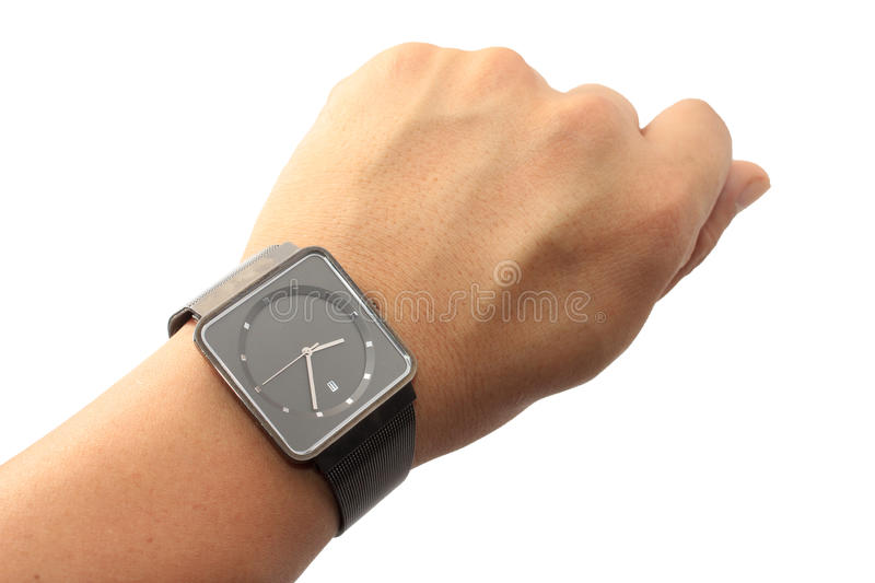 Watch on wrist. Isolated on white royalty free stock image