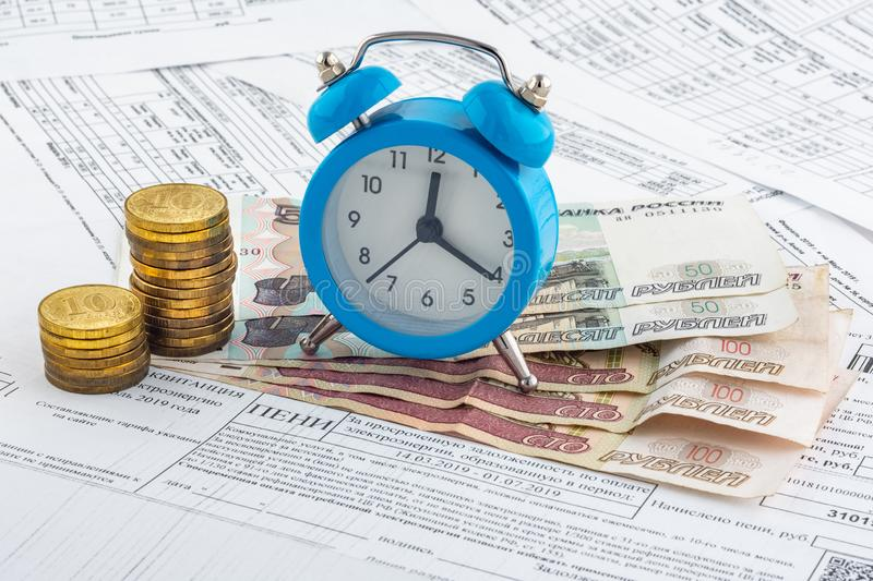 Watches, paper rubles, coins on receipts with penalties for payment. Watches, paper rubles, coins on receipts with penalties for  payment royalty free stock images